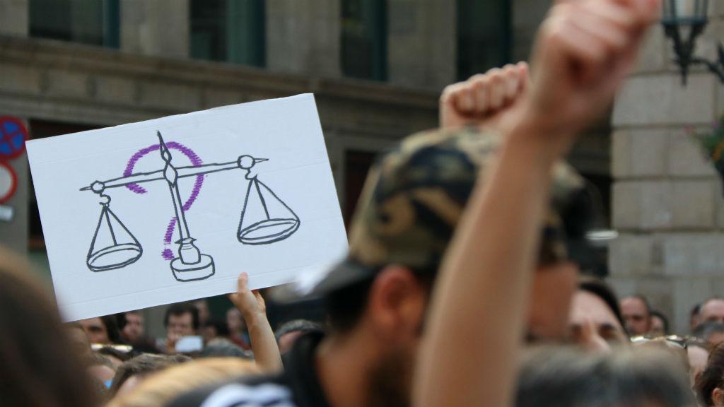 Cartell justícia concentració manada