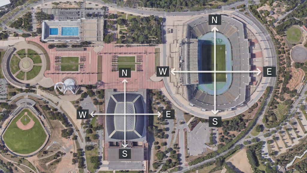 l'Estadi Olímpic de Montjuïc i el Palau Sant Jordi, orientats de nord a sud