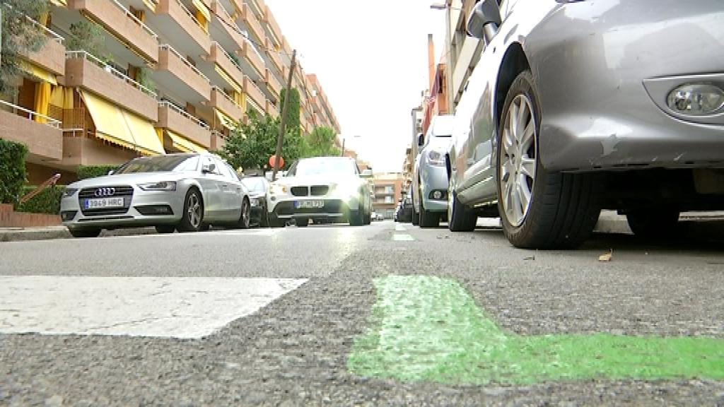 àrea verda aparcament